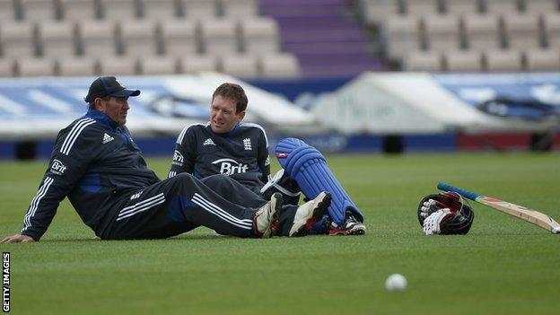England batting coach Graham Gooch (left) talks to Eoin Morgan