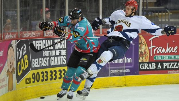 Daymen Rycroft of the Belfast Giants in action against Michal Benadik of the Edinburgh Capitals in the Elite League game in Belfast