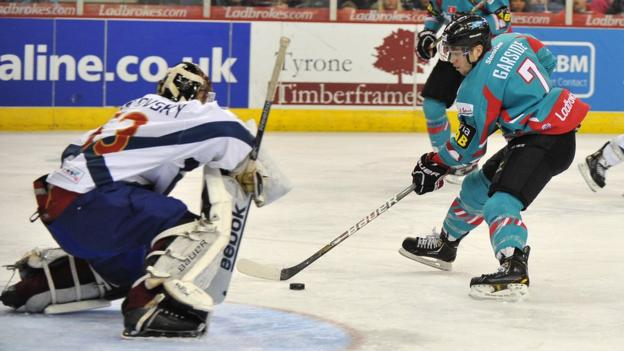 Mark Garside of the Belfast Giants scores the first goal past Tomas Hiadlousky