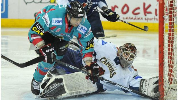Daymen Rycroft of the Belfast Giants in action against Tomas Hiadlousky of the Edinburgh Capitals