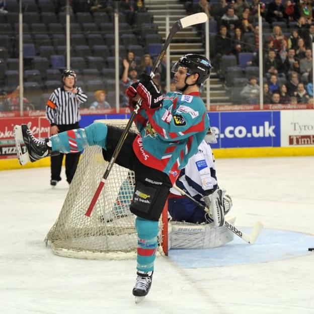 Craig Peacock of the Belfast Giants celebrates after scoring the second goal against the Edinburgh Capitals