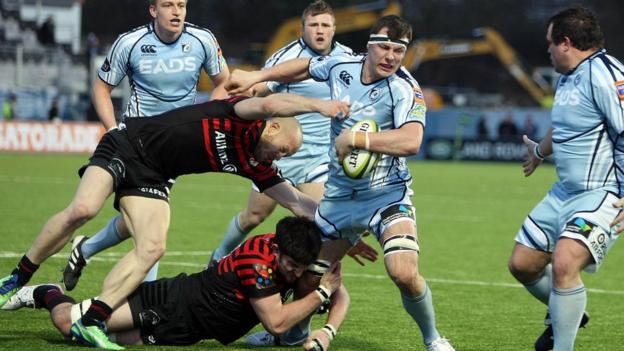 Cardiff Blues try scorer Robin Copeland struggles to shake off the tackles of the Saracens defence during his side's LV= Cup defeat at Allianz Park.