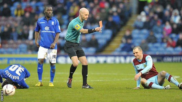 Burnley's Dean Marney is shown a red card against Birmingham