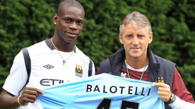 Mario Balotelli and Manchester City manager Roberto Mancini