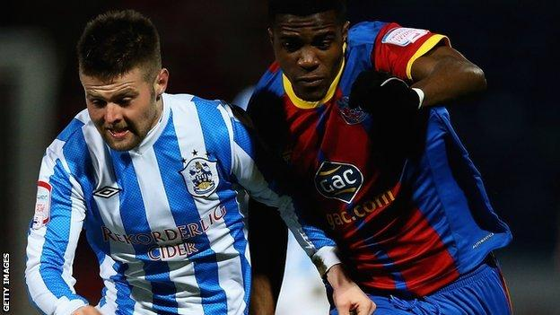 Oliver Norwood (left) and Wilfried Zaha