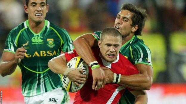 Wales Sevens' Rhys Jones is tackled by South Africa's Stephan Dippenaar at the IRB Wellington Sevens.