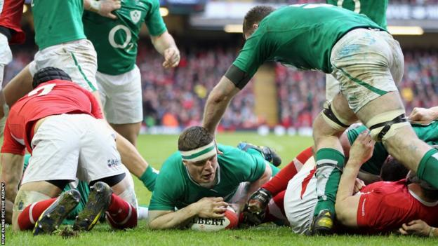 Centre Brian O'Driscoll scores Ireland's third try against Wales, diving over from a close-range ruck