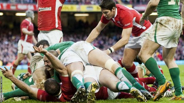 Wales replacement prop Craig Mitchell bundles over for a late try but it is not enough to stop Ireland triumphing 30-22 in Cardiff