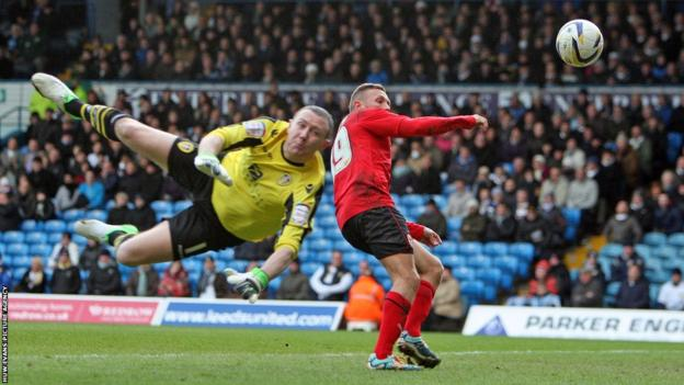 In the Championship clash at Elland Road, Cardiff striker Craig Bellamy's effort beats Leeds keeper Paddy Kenny but the goal is ruled out for offside.
