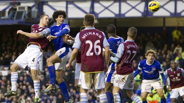 Marouane Fellaini (second left) heads in his side's equaliser against Aston Villa