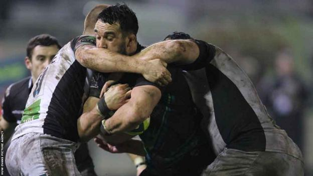 Jonathan Thomas is halted as the Ospreys lose 16-12 to Harlequins in the LV= Cup at Bridgend's Brewery Field