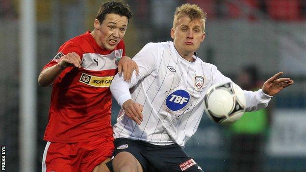 Cliftonville's Tomas Cosgrove is challenged by Coleraine opponent Aaron Boyd