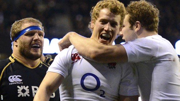 Joe Launchbury (right) congratulates Billy Twelvetrees on his maiden England try as Scotland prop Euan Murray looks on