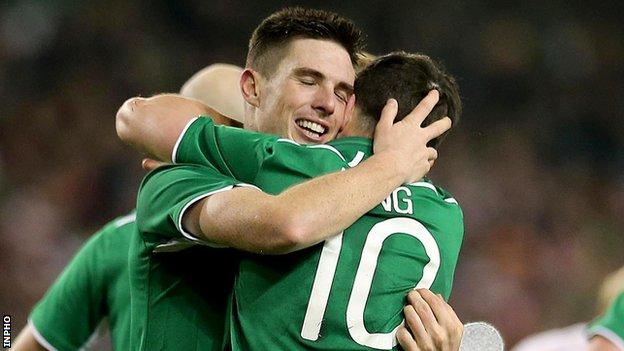 Ciaran Clark celebrates with Shane Long after scoring the Republic's first goal against Poland