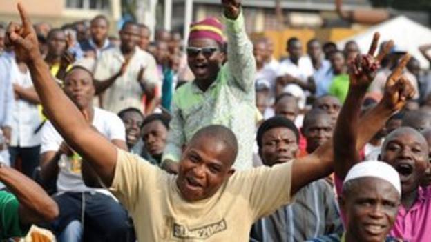 Fans celebrate Nigeria's win over Mali at a public viewing centre in the Nigerian city Lagos.