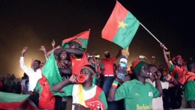 Burkina Faso fans celebrate victory at a viewing centre in Ouagadougou