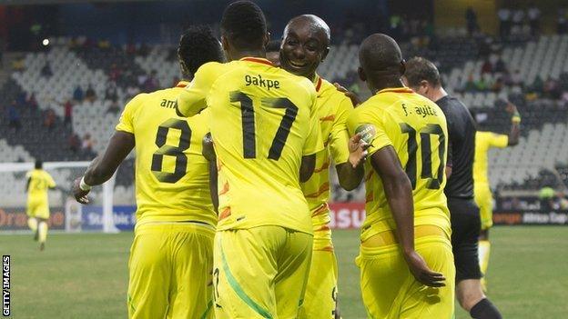 Togo players celebrate scoring against Tunisia