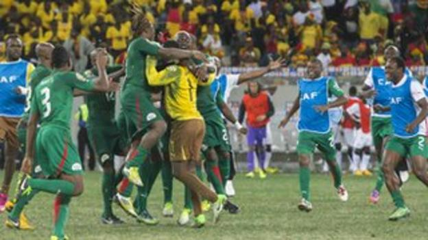 Burkinabe players celebrate their dramatic penalty shoot-out victory over Ghana