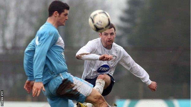Ballymena striker Gary Liggett in action against Ryan McIlmoyle of Coleraine