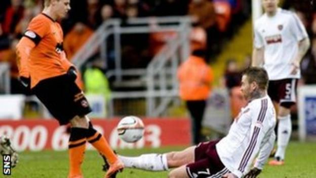 Hearts midfielder Ryan Stevenson tackles Gary Mackay-Steven and is subsequently sent off