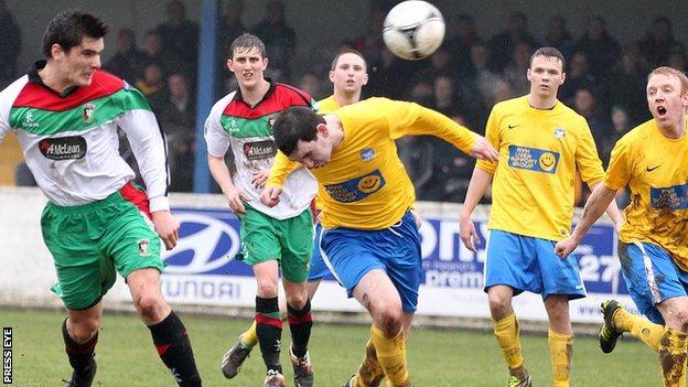 Jimmy Callacher heads Glentoran's equaliser away to Bangor