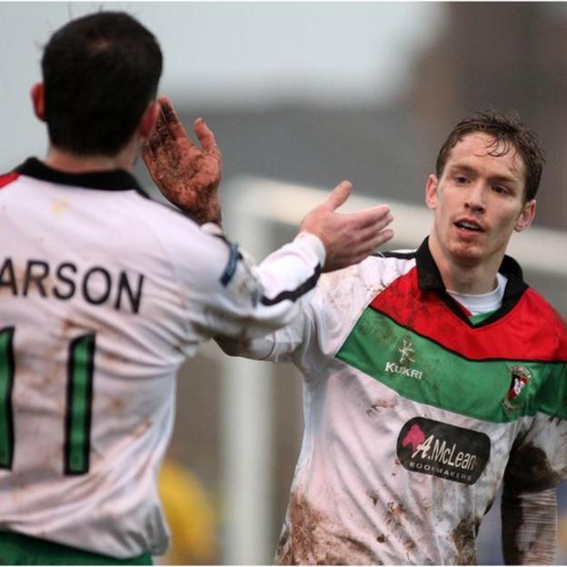 Stephen Carson congratulates David Howland who scored Glentoran's fifth goal in their Irish Cup win away to Bangor