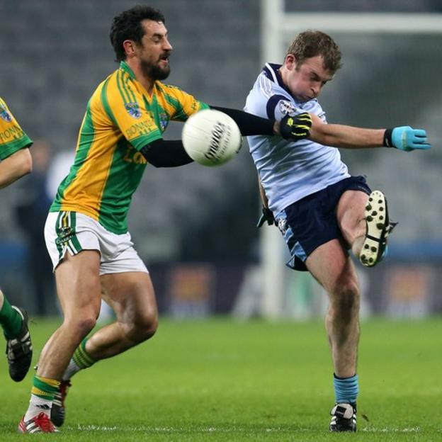 Finuge half-forward Paul Galvin attempts to block the clearance of Brian Mulligan during the All-Ireland Intermediate Club final in Dublin