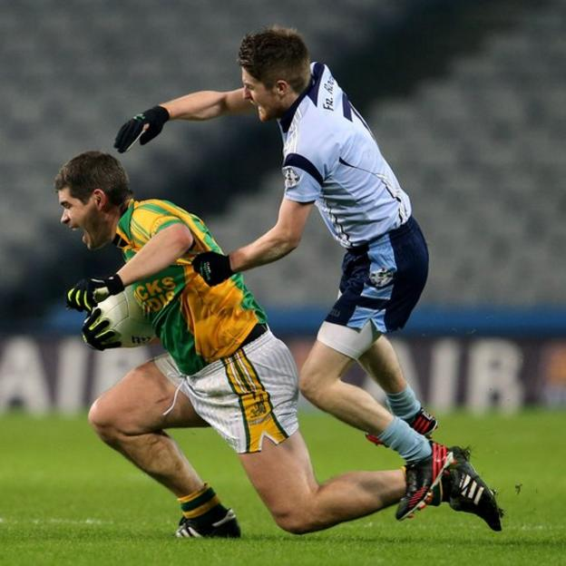 Finuge forward Eamonn Fitzmaurice is challenged by Martin Hughes of Father Rock's during the final at Croke Park