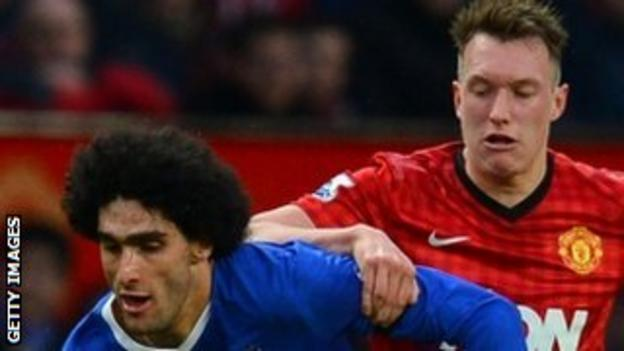 Manchester United's Phil Jones keeps a close eye on Everton's Marouane Fellaini
