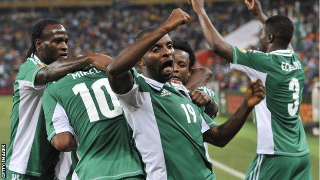 Nigeria's Sunday Mba (centre) celebrates after scoring against Burkina Faso