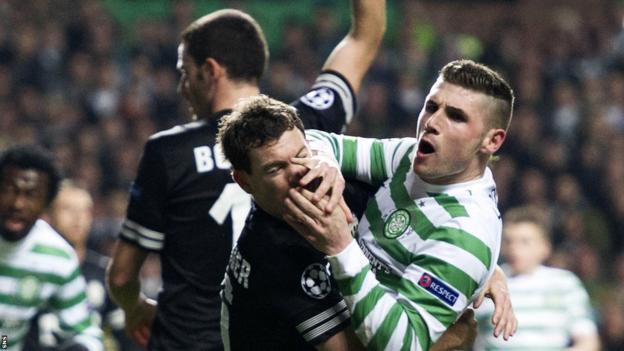 Celtic striker Gary Hooper (right) tussles with Stephan Lichsteiner