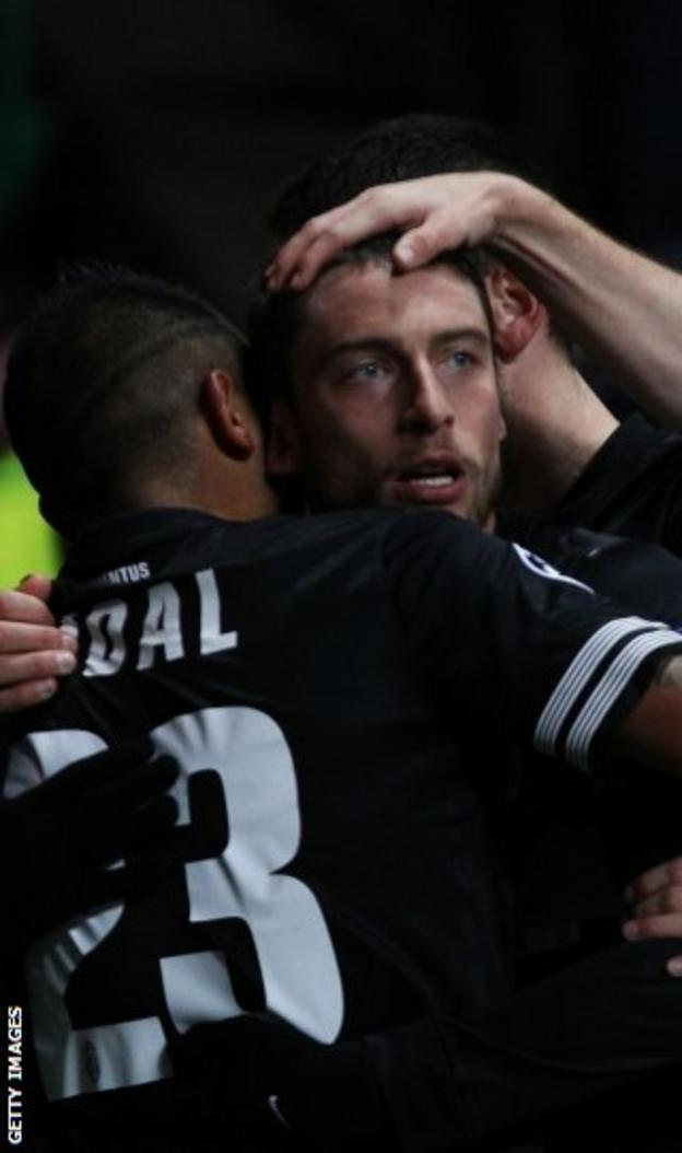 Claudio Marchisio is congratulated by his Juventus team-mates