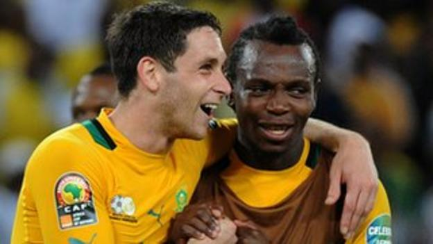 South African midfielder Dean Furman (L) celebrates his team's progression from the group stage