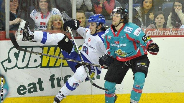 Daryl Lloyd puts in a big hit on Benn Olson in Saturday's game at the Odyssey Arena