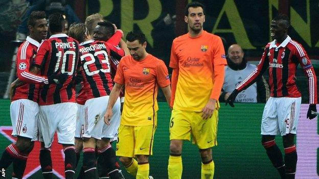 Milan celebrate scoring against Barcelona