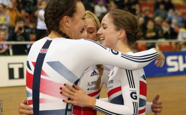 Elinor Barker (right) celebrates with team-mates Laura Trott and Dani King after securing Britain's first gold medal of the World Championships in the women's team pursuit.