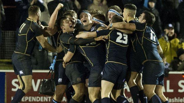Scotland celebrate on the final whistle at Netherdale
