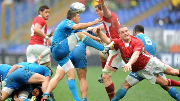 Wales prop Gethin Jenkins charges down Italy's Edoardo Gori's clearance in the Six Nations in Rome