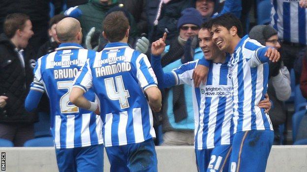 Leonardo Ulloa (r) and David Lopez (second r) celebrate Lopez's goal