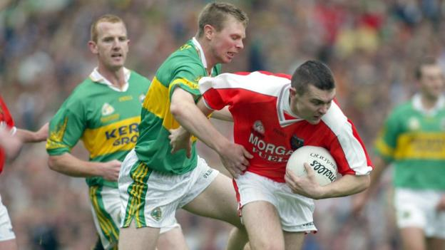 Tomás Ó Sé of Kerry challenges Oisin McConville during the 2002 All-Ireland Football Championship final at Croke Park