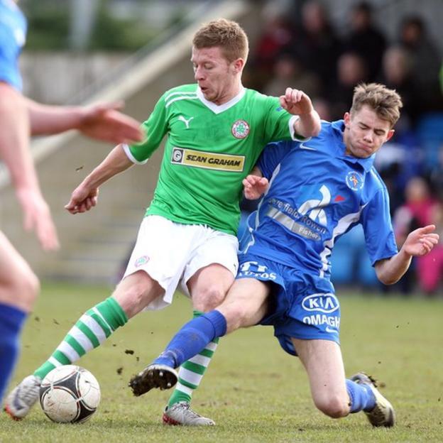 Stephen Garrett of Cliftonvillle is tackled by Gary Phair of Ballinamallard