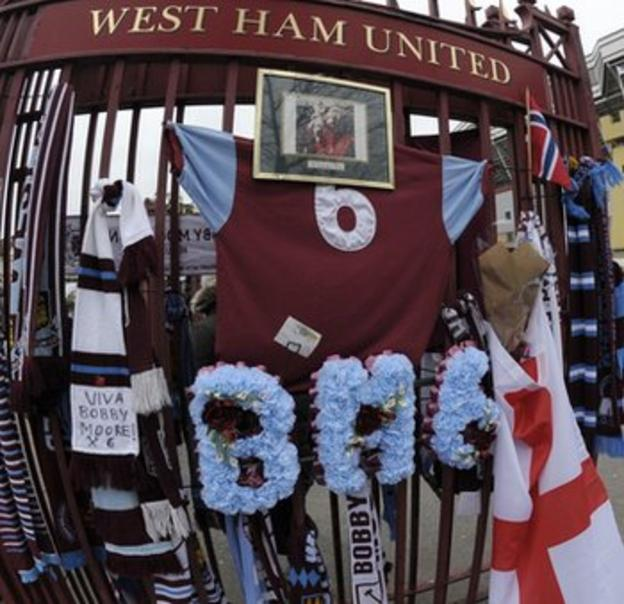 Fans laid scarves at the gates to West Ham's ground