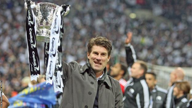 Swansea City manager Michael Laudrup celebrates at Wembley, describing the Capital One Cup win as the most important of his career