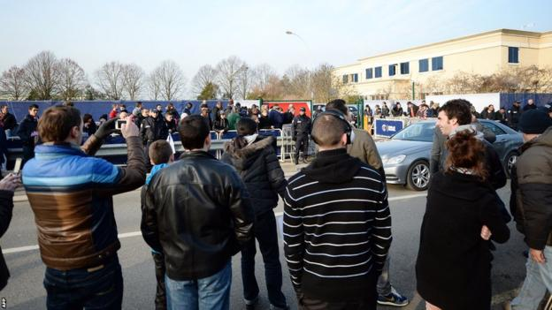 Paris St-Germain supporters gather around the club's Camp des Loges training centre