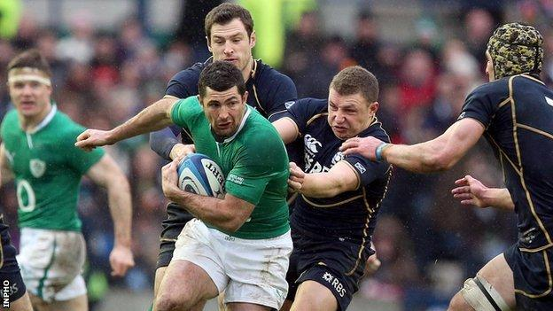 Rob Kearney is tackled by Tim Visser and Duncan Weir in Sunday's match at Murrayfield