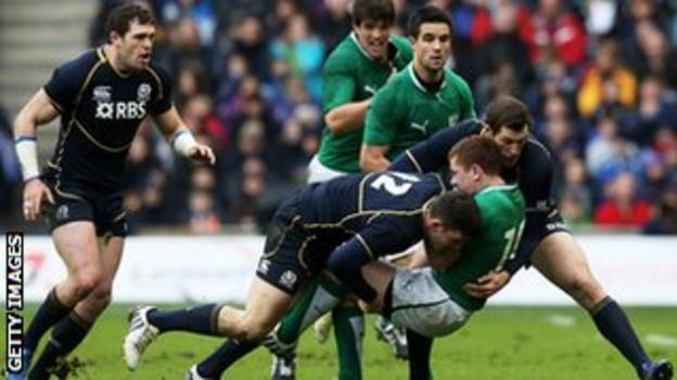 Ireland's Paddy Jackson is halted by Matthew Scott and Tim Visser