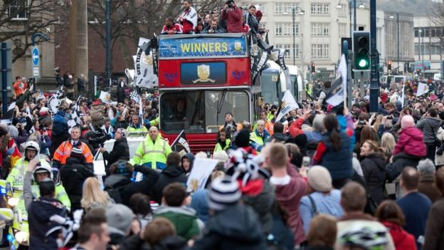 The celebration parade begins as Swansea fans gather to see their Capital One Cup heroes travel through the city on their victory parade