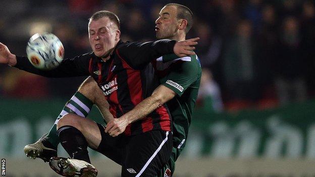 Crusaders striker Jordan Owens competes against Dan Murray of Cork City