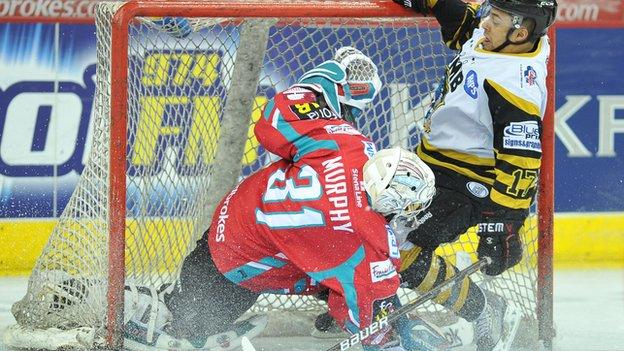 Matt Francis of the Nottingham Panthers crashes into Stephen Murphy of the Belfast Giants