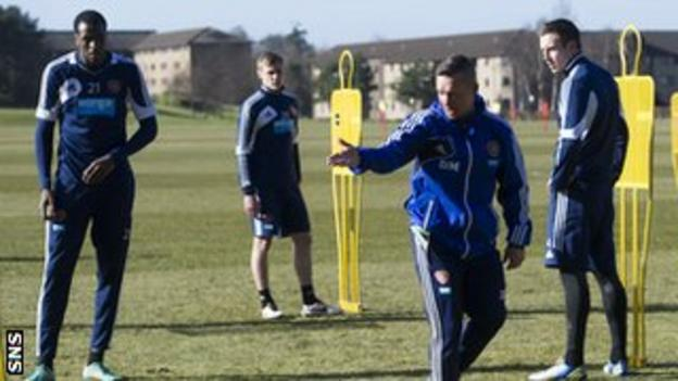 Darren Murray oversees Hearts training
